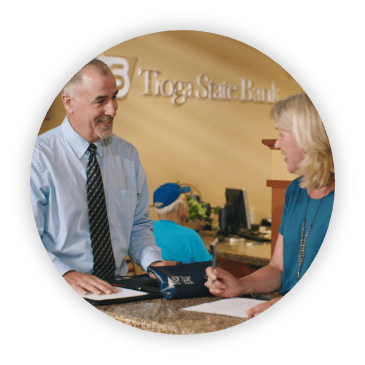 man speaking with woman at tioga bank